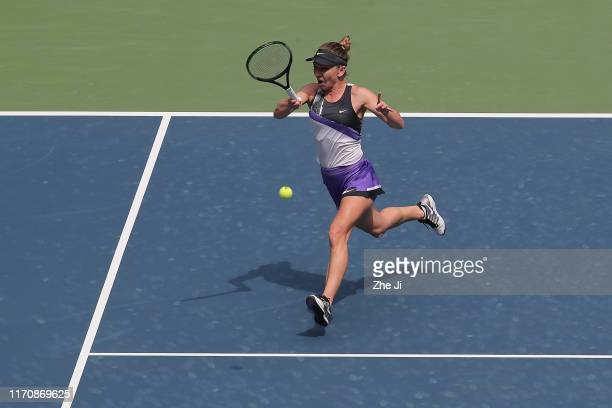 Simona halep of Romania returns a shot during the match against Elena Rybakina of Kazakhstan on Day 4 of 2019 Dongfeng Motor Wuhan Open at Optics...