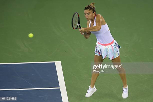 Simona Halep of Romania returns a shot during the match against Madison Keys of USA on Day 5 of the 2016 Dongfeng Motor Wuhan Open at the Optics...