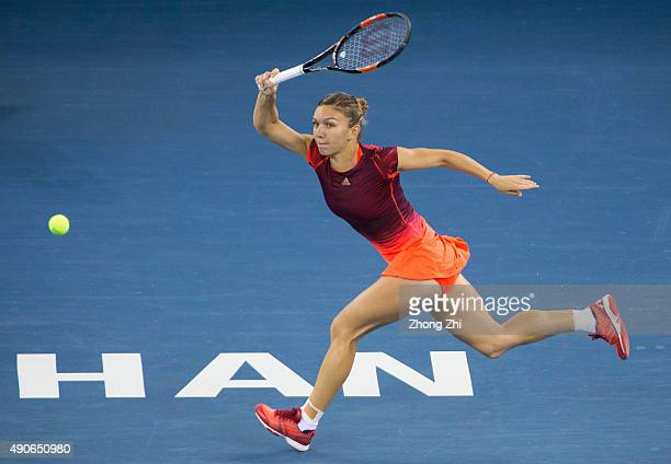Simona Halep of Romania returns a shot during the match against Johanna Konta of Great Britain on Day 4 of 2015 Dongfeng Motor Wuhan Open at Optics...