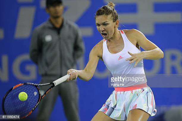 Simona Halep of Romania returns a shot during the Semi final match against Petra Kvitova of Czech on day 6 of the 2016 Dongfeng Motor Wuhan Open at...
