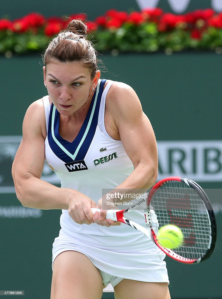 Simona Halep of Romania returns a shot to Eugenie Bouchard of Canada during the BNP Paribas Open at Indian Wells Tennis Garden on March 9, 2014 in Indian Wells, California. (Photo by Stephen Dunn/Getty Images).