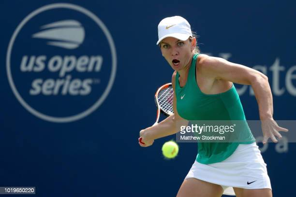 Simona Halep of Romania returns a shot to Kiki Bertens of Netherlands after their match during the women's final of the Western Southern Open at...