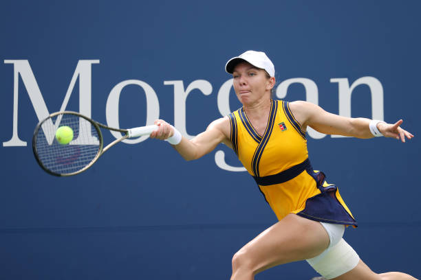 Simona Halep of Romania returns against Camila Giorgi of Italy during their women's singles first round match on Day One of the 2021 US Open at the...