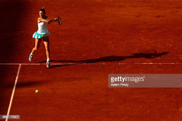 Simona Halep of Romania returns the ball during the ladies singles first round match against Jana Ceepelova of Slovakia on day three of the 2017...