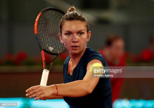 Simona Halep of Romania returns the ball to Anastasija Sevastova of Latvia during the Mutua Madrid Open semi final tennis match at the La Caja Magica...