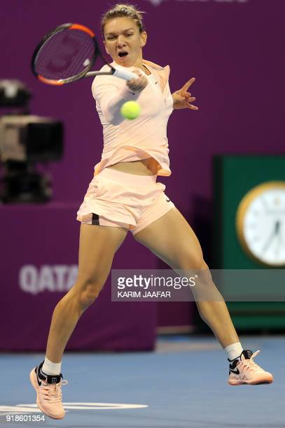 Simona Halep of Romania returns the ball to Anastasija Sevastova of Latvia while competing in the round of 16 during the Qatar Open tennis...