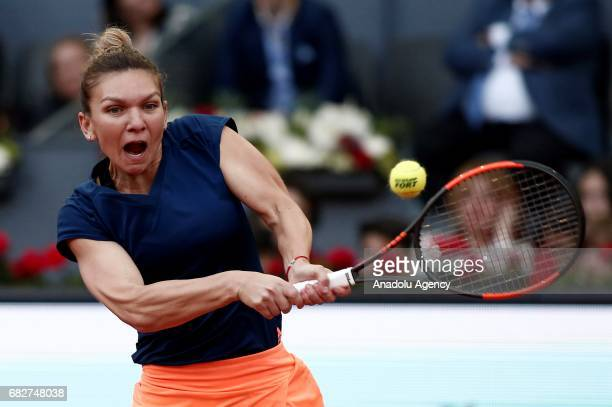 Simona Halep of Romania returns the ball to Kristina Mladenovic of France during the Mutua Madrid Open final tennis match at La Caja Magica on May13...