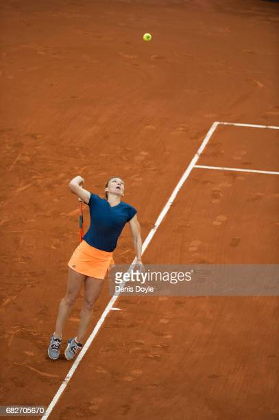 Simona Halep of Romania serves against Kristina Mladenovic of France in their final match during day eight of the Mutua Madrid Open tennis at La Caja...