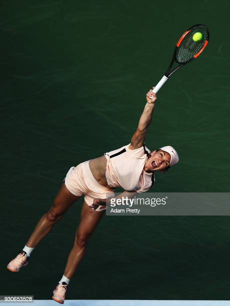 Simona Halep of Romania serves during her match against Caroline Dolehide of the USA during the BNP Paribas Open at the Indian Wells Tennis Garden of...