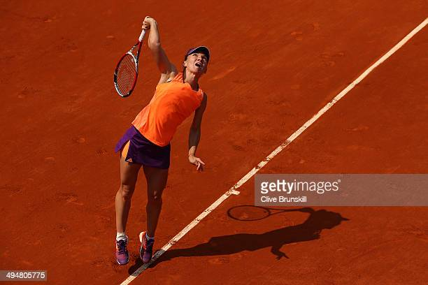 Simona Halep of Romania serves during her women's singles match against Maria Teresa Torro Flor of Spain on day seven of the French Open at Roland...