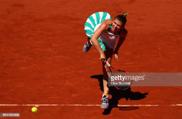Simona Halep of Romania serves during the ladies singles final match against Jelena Ostapenko of Latvia on day fourteen of the 2017 French Open at...