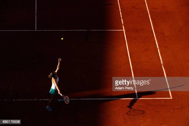 Simona Halep of Romania serves during the ladies singles first round match against Jana Ceepelova of Slovakia on day three of the 2017 French Open at...