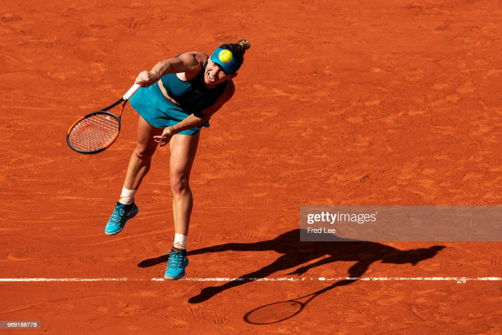 Simona Halep of Romania serves during the ladies' singles semi-final match against Garbine Murguruza of Spain during day twelve of the 2018 French Open at Roland Garros on June 7, 2018 in Paris, France.