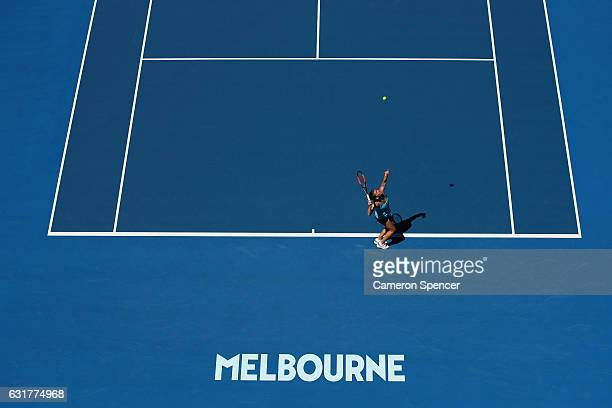 Simona Halep of Romania serves in her first round match against Shelby Rogers of the Uniuted States on day one of the 2017 Australian Open at...