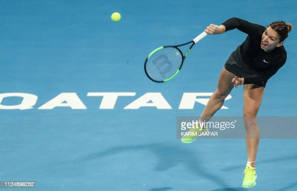 Simona Halep of Romania serves the ball during her WTA Qatar Open quarterfinal tennis match against Julia Goerges of Germany in Doha on February 14...