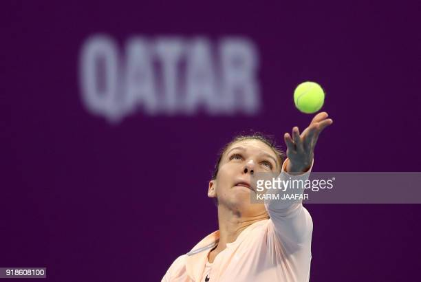 Simona Halep of Romania serves the ball to Anastasija Sevastova of Latvia while competing in the round of 16 during the Qatar Open tennis competition...