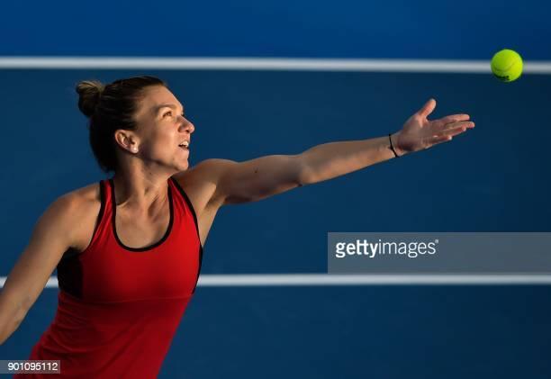 Simona Halep of Romania serves to Aryna Sabalenka of Belarus during their women's singles quarterfinal match at the WTA Shenzhen Open tennis...