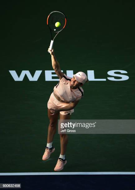 Simona Halep of Romania serves to Caroline Dolehide during the BNP Paribas Open on March 11 2018 at the Indian Wells Tennis Garden in Indian Wells...