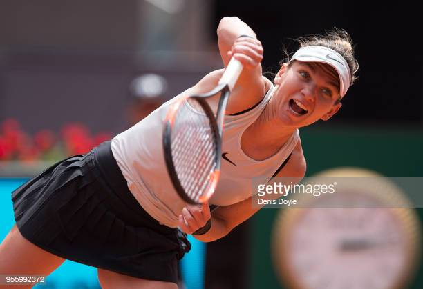 Simona Halep of Romania serves to Elise Mertens of Belgium in the 2nd Round match during day four of the Mutua Madrid Open tennis tournament at the...