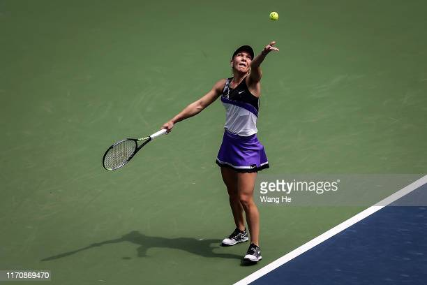 Simona halep of Romania severs during the match against Elena Rybakina of Kazakhstan on Day 4 of 2019 Dongfeng Motor Wuhan Open at Optics Valley...