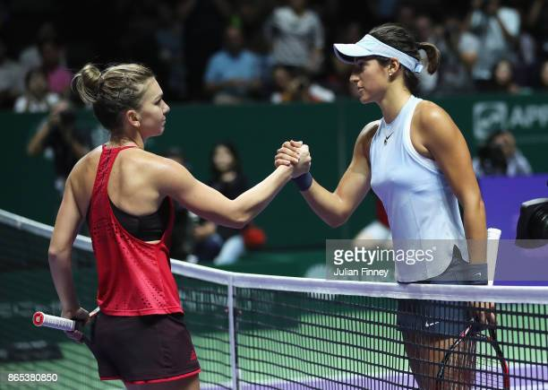 Simona Halep of Romania shakes hands with Caroline Garcia of France after her victory in their singles match during day 2 of the BNP Paribas WTA...