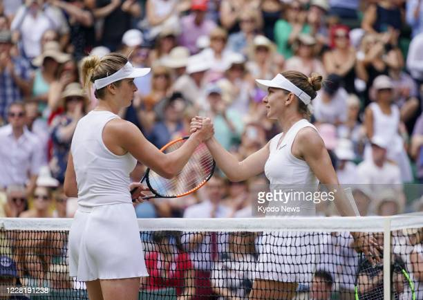 Simona Halep of Romania shakes hands with Elina Svitolina after beating the Ukrainian in their semifinal at the Wimbledon tennis tournament in London...