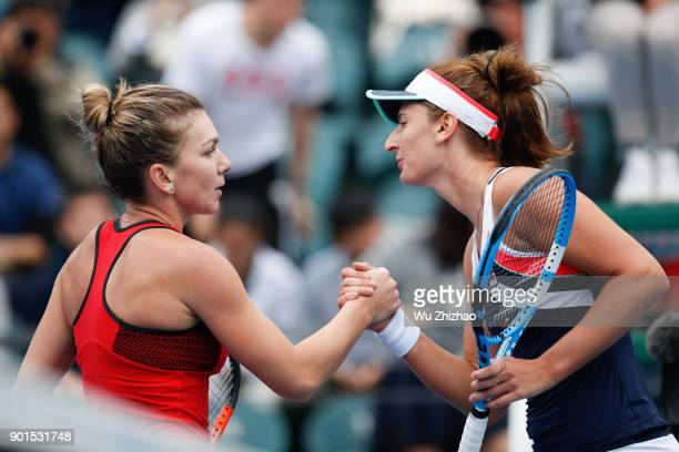 Simona Halep of Romania shakes hands with Irina-Camelia Begu of Romania after their semi-final match on Day 6 of 2018 WTA Shenzhen Open at Longgang...