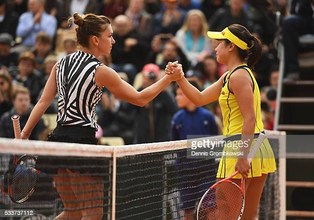 Simona Halep of Romania shakes hands with Nao Hibino of Japan following the Women's Singles first round match day two of the 2016 French Open at...