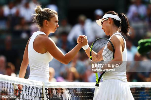 Simona Halep of Romania shakes hands with Saisai Zheng of China after their Ladies' Singles second round match on day four of the Wimbledon Lawn...
