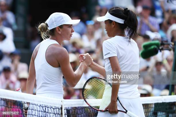 Simona Halep of Romania shakes hands with SuWei Hsieh of Taiwan after her Ladies' Singles third round match on day six of the Wimbledon Lawn Tennis...