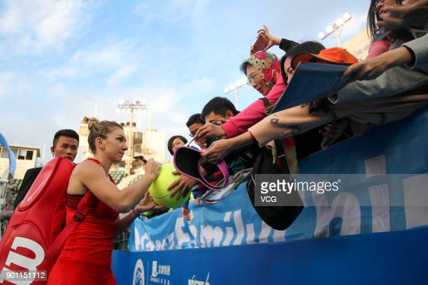 Simona Halep of Romania signs name for fans during the quarterfinal match against Aryna Sabalenka of Belarus on day 5 of 2018 WTA Shenzhen Open at...