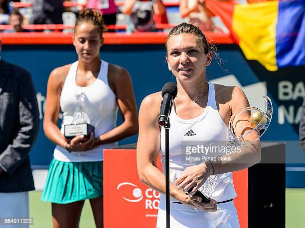 Simona Halep of Romania speaks to the fans after defeating Madison Keys of the United States during day seven in final round action of the Rogers Cup...