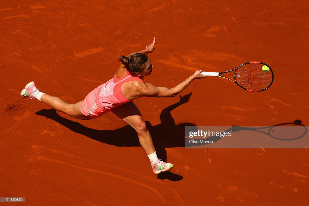 Simona Halep of Romania stretches for a forehand in her Women's Singles match against Mirjana Lucic-Baroni of Croatia during day four of the 2015 French Open at Roland Garros on May 27, 2015 in Paris, France.