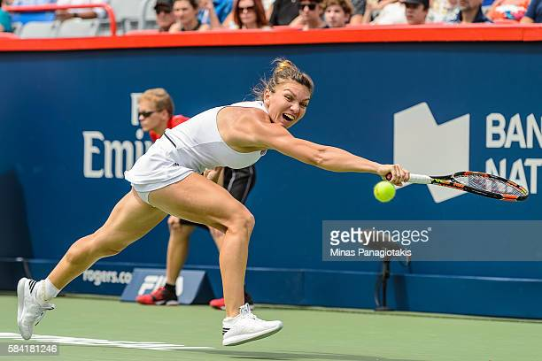 Simona Halep of Romania stretches for the ball against Karolina Pliskova of Czech Republic during day four of the Rogers Cup at Uniprix Stadium on...
