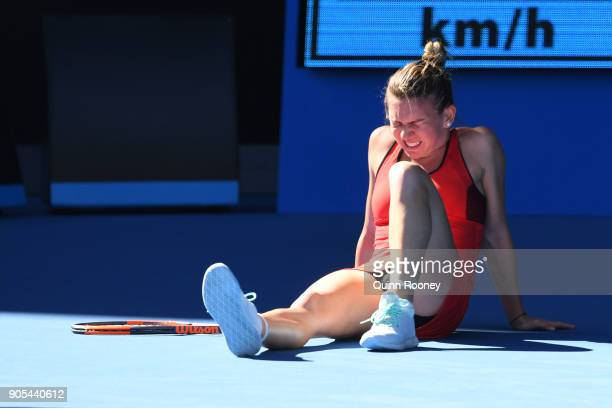 Simona Halep of Romania struggles after injuring her ankle in her first round match against Destanee Aiava of Australia on day two of the 2018...