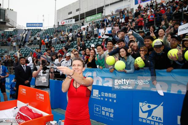 Simona Halep of Romania takes a selfie with fans after winning her semifinal match against IrinaCamelia Begu of Romania on Day 6 of 2018 WTA Shenzhen...