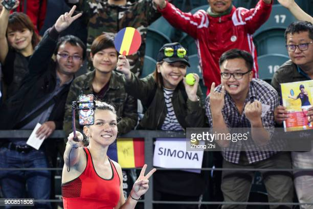 Simona Halep of Romania takes selfie with fans after winning the match against Yingying Duan of China during Day 4 of 2018 WTA Shenzhen Open at...