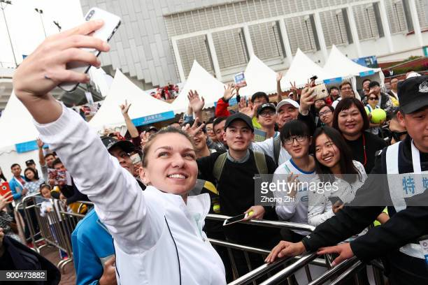 Simona Halep of Romania takes selfie with fans during Day 3 of 2018 WTA Shenzhen Open at Longgang International Tennis Center on January 2 2018 in...