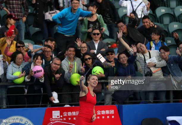 Simona Halep of Romania takes selfie with fans during the quarterfinal match against Aryna Sabalenka of Belarus on day 5 of 2018 WTA Shenzhen Open at...