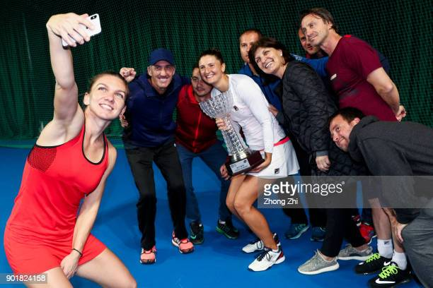 Simona Halep of Romania takes selfie with her doubles partner IrinaCamelia Begu of Romania and the team during Day 7 of 2018 WTA Shenzhen Open at...