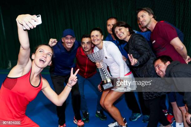 Simona Halep of Romania takes selfie with her Singles and Doubles Champion trophies with her doubles partner IrinaCamelia Begu of Romania and the...