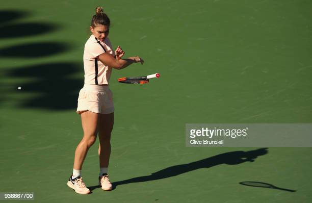 Simona Halep of Romania throws her racquet in frustration against Oceane Dodin of France in their second round match during the Miami Open Presented...