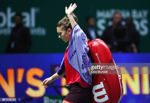 Simona Halep of Romania walks off court after her defeat to Elina Svitolina of Ukraine in their singles match during day 6 of the BNP Paribas WTA...