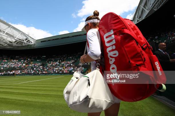 Simona Halep of Romania walks onto court one prior to her Ladies' Singles first round match during Day one of The Championships - Wimbledon 2019 at...