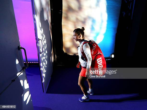 Simona Halep of Romania walks out onto the court prior to her round robin match against Maria Sharapova of Russia during the BNP Paribas WTA Finals...