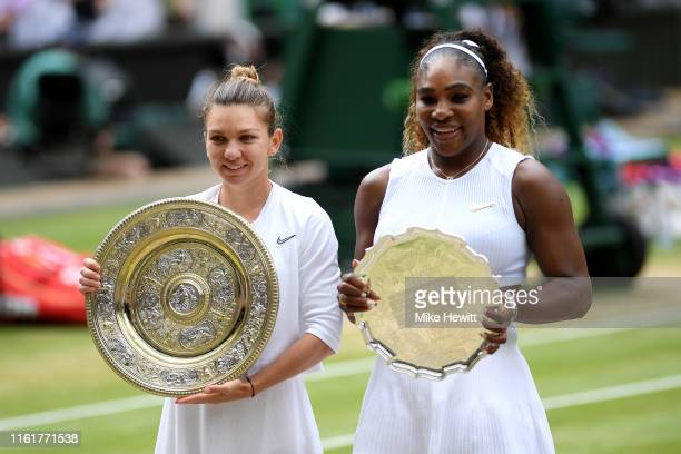 Simona Halep of Romania winner and Serena Williams of The United States runnerup pose for a photo with their respective trophies after the Ladies'...
