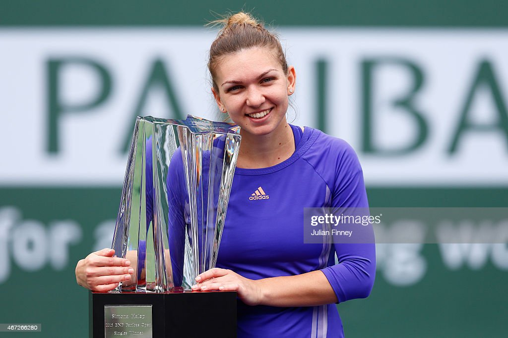 Simona Halep of Romania with the winners trophy after defeating Jelena Jankovic of Serbia in the final during day fourteen of the BNP Paribas Open tennis at the Indian Wells Tennis Garden on March 22, 2015 in Indian Wells, California.