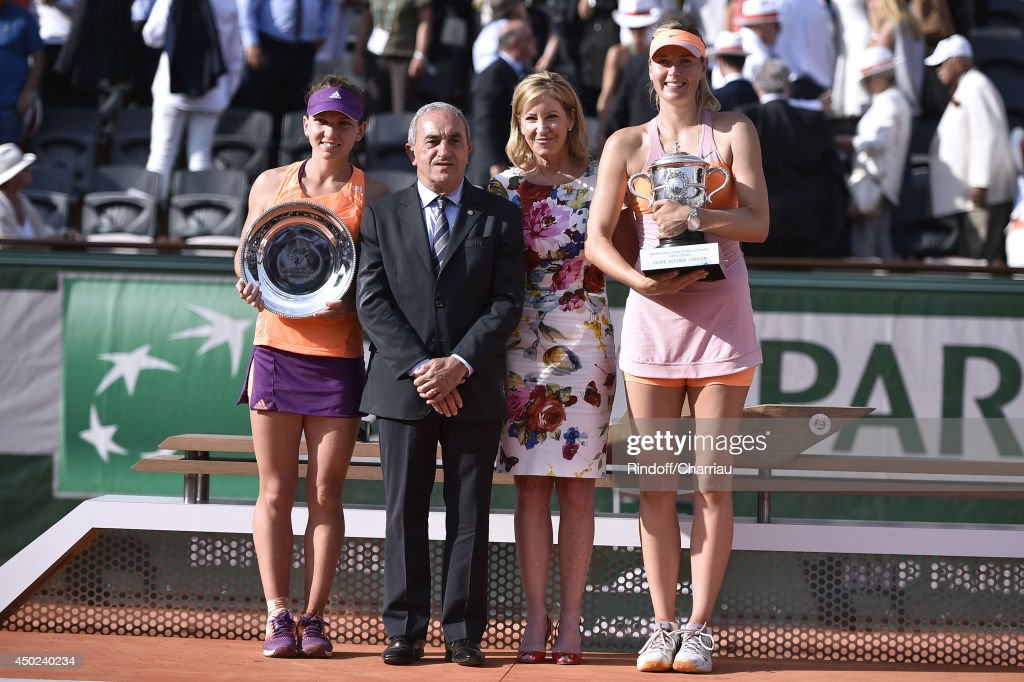 Simona Halep, President of FFT Jean Gachassin, former tennis player Chris Evert and Maria Sharapova pose after Tennis player Maria Sharapova wins, against Simona Halep, the Roland Garros French Tennis Open 2014 - Day 14 on June 7, 2014 in Paris, France.