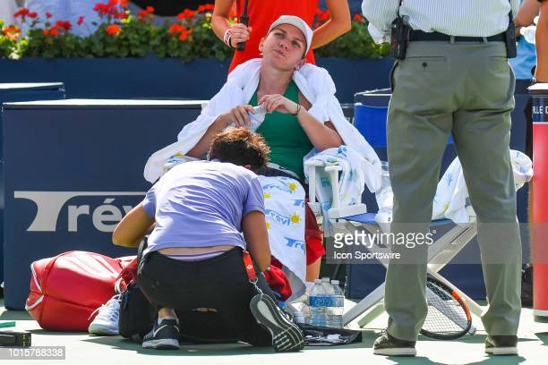 Simona Halep receives medical attention during the WTA Coupe Rogers final on August 12, 2018 at IGA Stadium in Montréal, QC