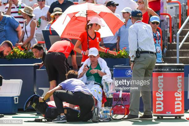 Simona Halep receives medical attention during the WTA Coupe Rogers final on August 12 2018 at IGA Stadium in Montréal QC